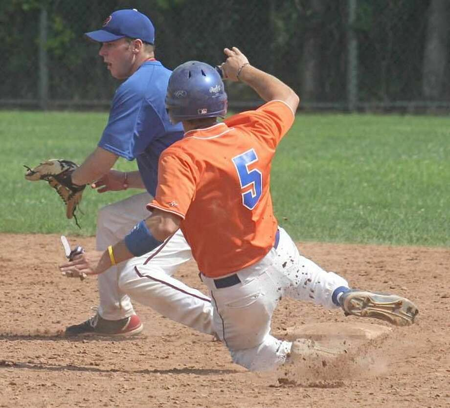 Photo by Russ McCreven Metro Taxi's Kyle Cummings steals second base as Bank of Southern Connecticut's Andrew Johnson reaches for the ball last week in the West Haven Twilight League.
