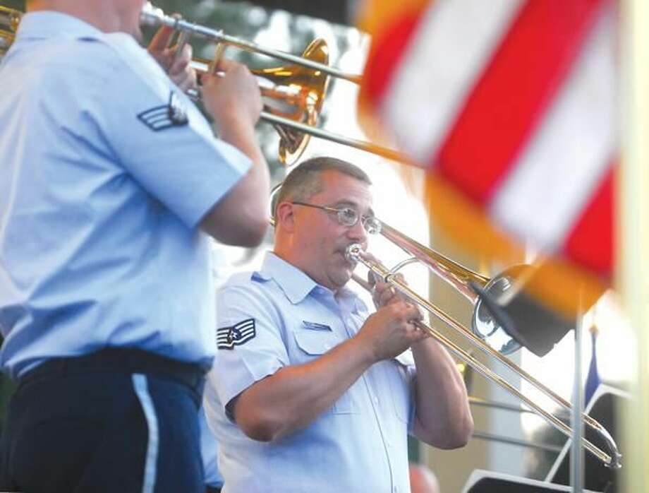 Photo by Brad Horrigan Staff Sgt. William Harris plays the trombone in the US Air Force Band of Liberty prior to fireworks at Town Center Park in Hamden Friday night.
