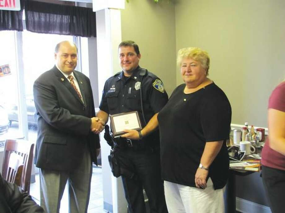 Submitted Photo Rotary Club President Rick DiNorscia and Program Chairwoman Mary Jane Mulligan thank Officer Thorpe.