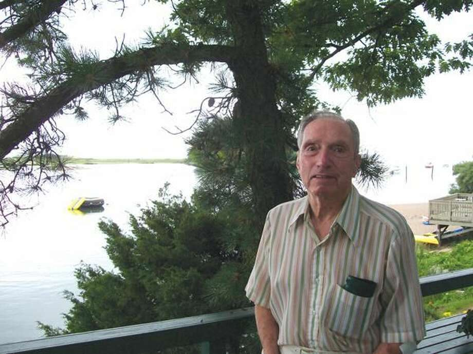 Photo by Lynn Fredricksen Long time pediatrician Dr. Harold Bornstein enjoys his view of the water from the back deck on his house overlooking the Farm River.