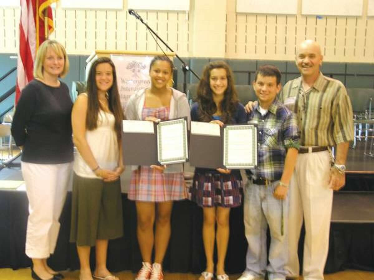 Submitted Photo Wintergreen Magnet School Principal Michelle Coogan (left) with Taylor Jacques and recipients Malka Berro and Taryn Anderson, and Jordan Jacques for whom the scholarship is named, with Paul Jacques.