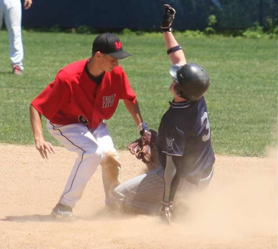 Photo by Russ McCreven Wallingford's Steve Lanzoni slaps the tag on a Madison player in a game played earlier this season. Wallingford finished the American Legion season with a 7-17 record.