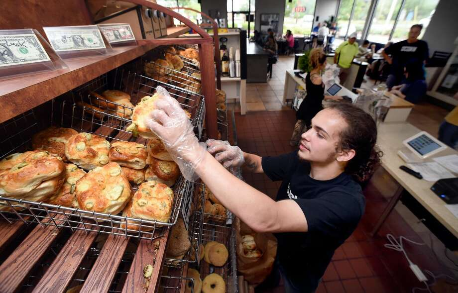 John Gildart stocks fresh bagels at the recently opened Bagelicious II at 91 Washington Ave. in North Haven.