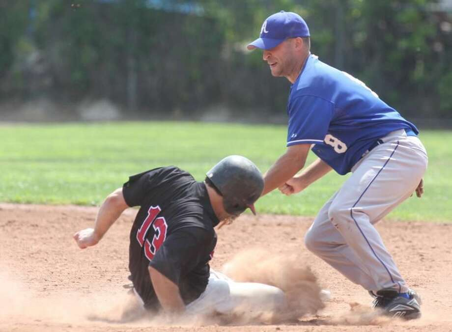 Photo by Russ McCreven A-Plus Plumbing shortstop Matt Denorfia tags out Bellows' Ron Williams in the recent NABF Northeast Regional tournament in West Haven. A-Plus advanced to the NABF World Series championship game on Sunday, but lost to the Beecher Muskies of Illinois by a 10-4 score.