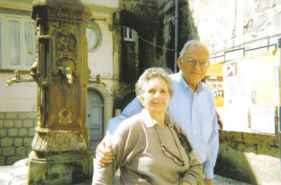 Submitted Photo Former Hamden Mayor Lucien DiMeo enjoys a visit to St. Lawrence, Italy with his cousin, Genesaga. The two are pictured in the square in front of the building where their grandparents and DiMeo's father once lived.