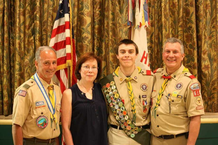 Eagle Scout Gordon Gaidish with parents Lori and Tom Gaidish and Scoutmaster Bill Earley.