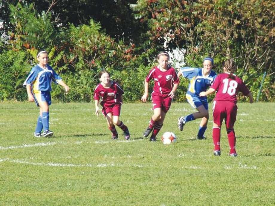 Submitted Photo The U12 Girls Rec play in last year's Festival of Angels soccer tournament.