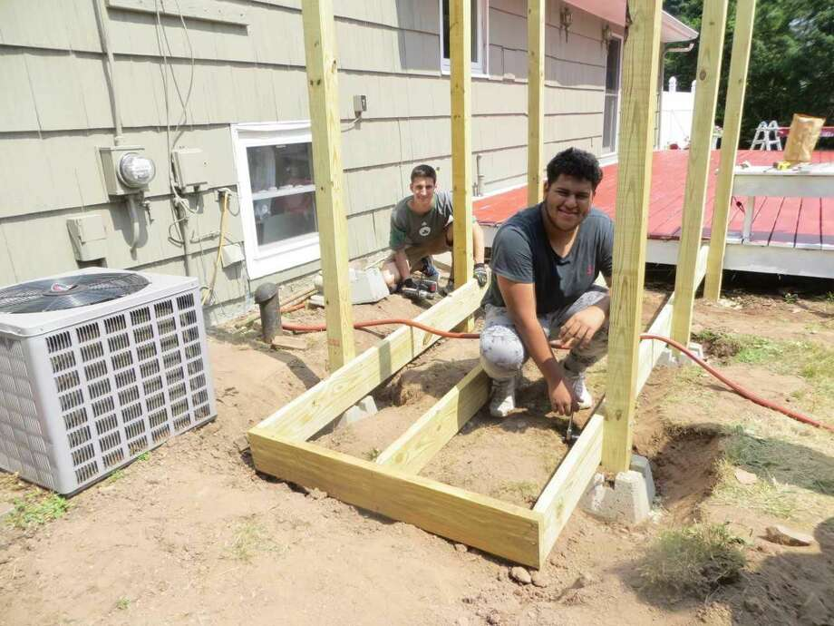 Volunteers work on a carpentry project in Wallingford.