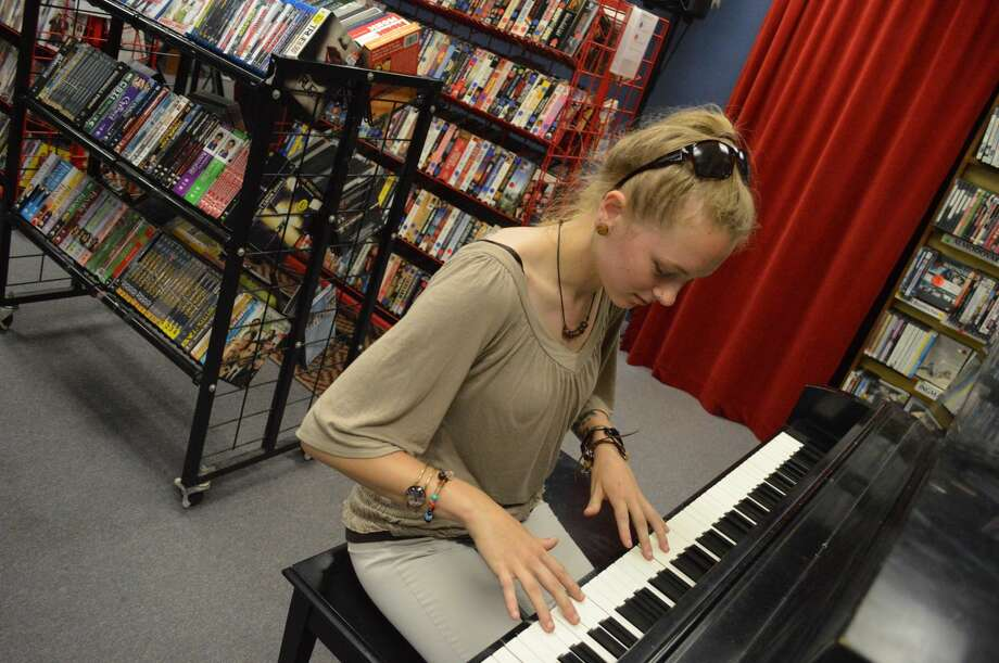 Alyssa Bowers of Wallingford plays the piano at the Best Video Film & Cultural Center.