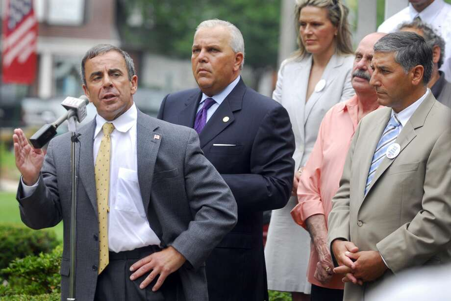 Republican Mike Freda, left, announces his candidacy for North Haven First Selectman during a press conference / rally on the North Haven Town Green in July, 2009.