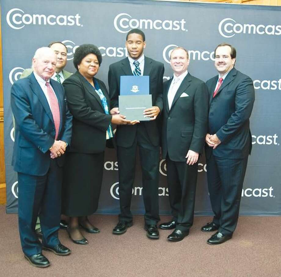 Submitted Photo Left to right: Connecticut State Senator Joseph J.Crisco; DPUC Commissioner Tony Palermino; Charisse Lillie, Comcast corporate vice president of community investment and executive vice president of the Comcast Foundation; 2010 CT Leaders & Achievers Scholarship Winner Martin Clark of Hamden; Eric Churchill; Doug Guthrie, Comcast senior vice president of the Western New England Region; and Mark Reilly, Comcast senior vice president of government relations for the NorthCentral Division.