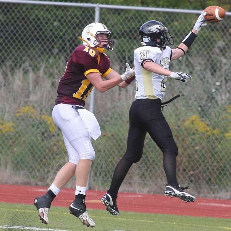 Photo by Russ McCreven Law's Connor Falaguerra breaks up a pass intended for Sheehan's Brian Murphy.