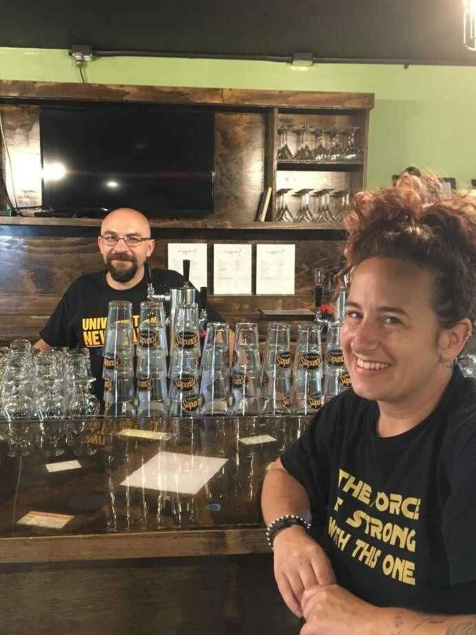 The Rough Draft owners Chris Scionti, left, and Karen Robinson, take a moment to talk about their new music bar, which opened last month in the building that used to be The Space at 295 Treadwell St. in Hamden.