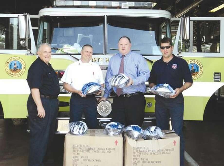 Submitted Photo Pictured left to right are Hamden Lodge Past President Bert Martus, Lt. Jeff Obier of the North Haven Fire Department, Firefighter Christopher Shea and Hamden Lodge President Tim Mayer.