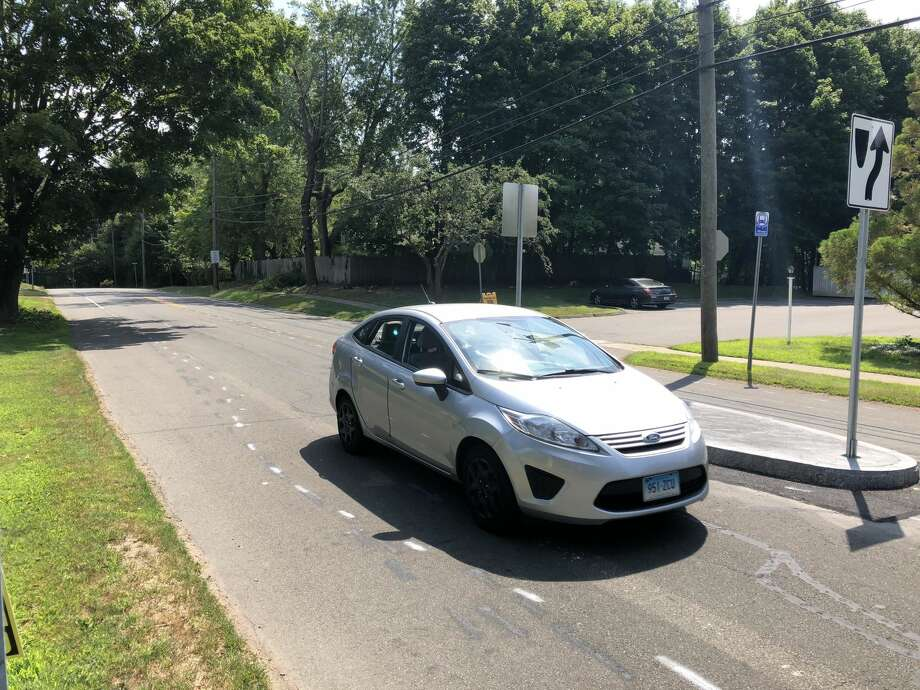 A vehicle passes by one of the new islands on Ridge Road in Hamden, before further painting in the area had been completed. Residents have recently raised concerns about he new installations.