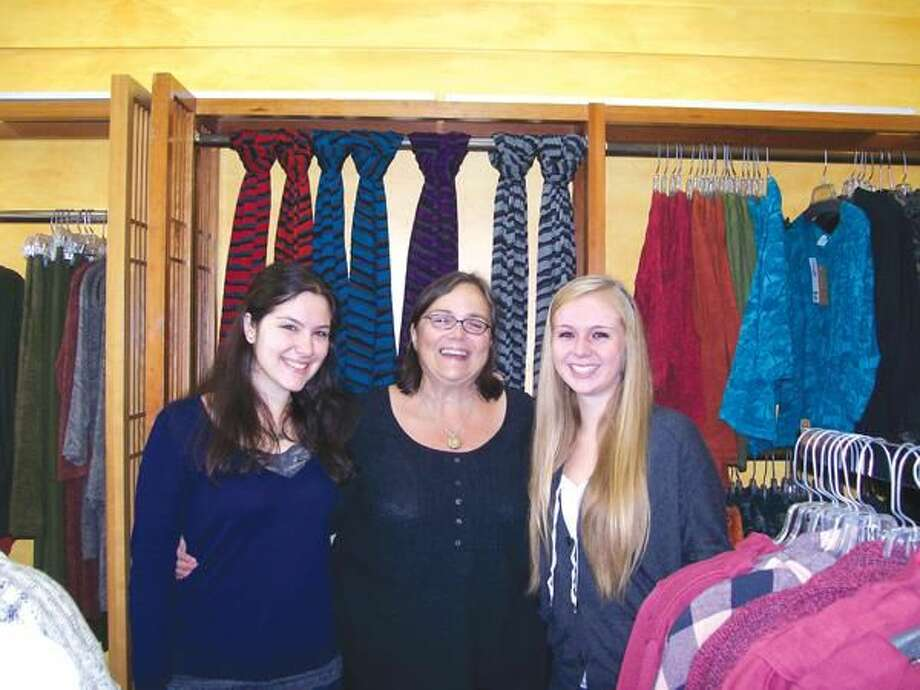 Photo by Lynn Fredricksen Dava boutique owner Coleen Campbell is flanked by two of her retail associates, Kimberly Staiano, left and Catherine Jones, right. They are gearing up for a special event to benefit Aids Project New Haven Friday, Sept. 24, from 6:30 to 8:30 p.m., at the store at 2100 Dixwell Ave. For details, call the store at 203-230-0039.