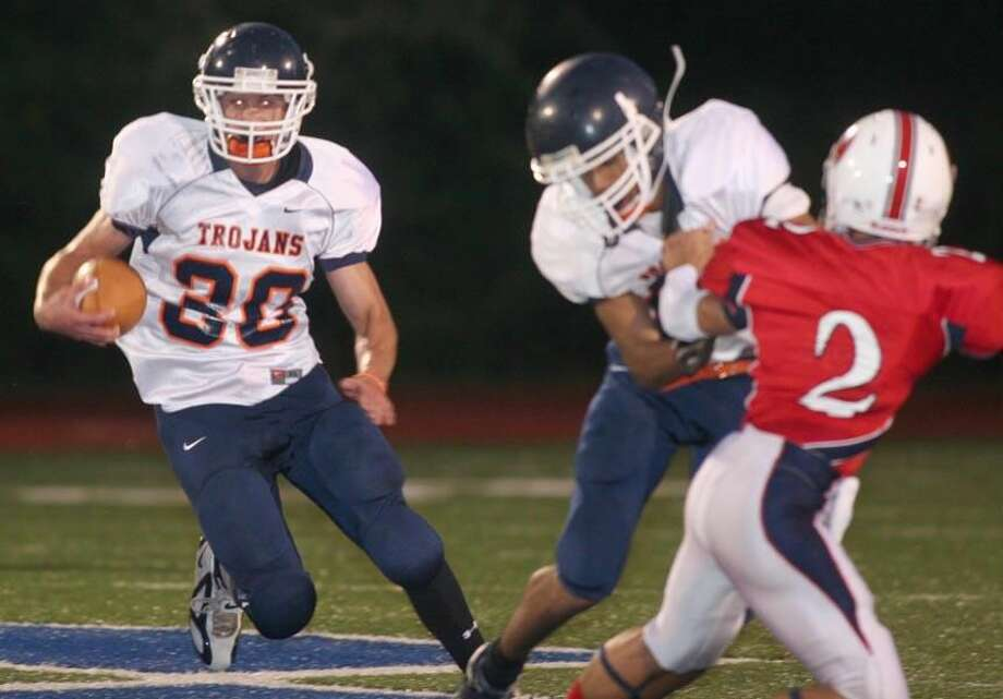 File photo by Russ McCreven Lyman Hall's Joe DeSandre carries the ball for the Trojans in a game played last season. Lyman Hall is a team to watch in the Southern Connecticut Conference's Division II this fall.