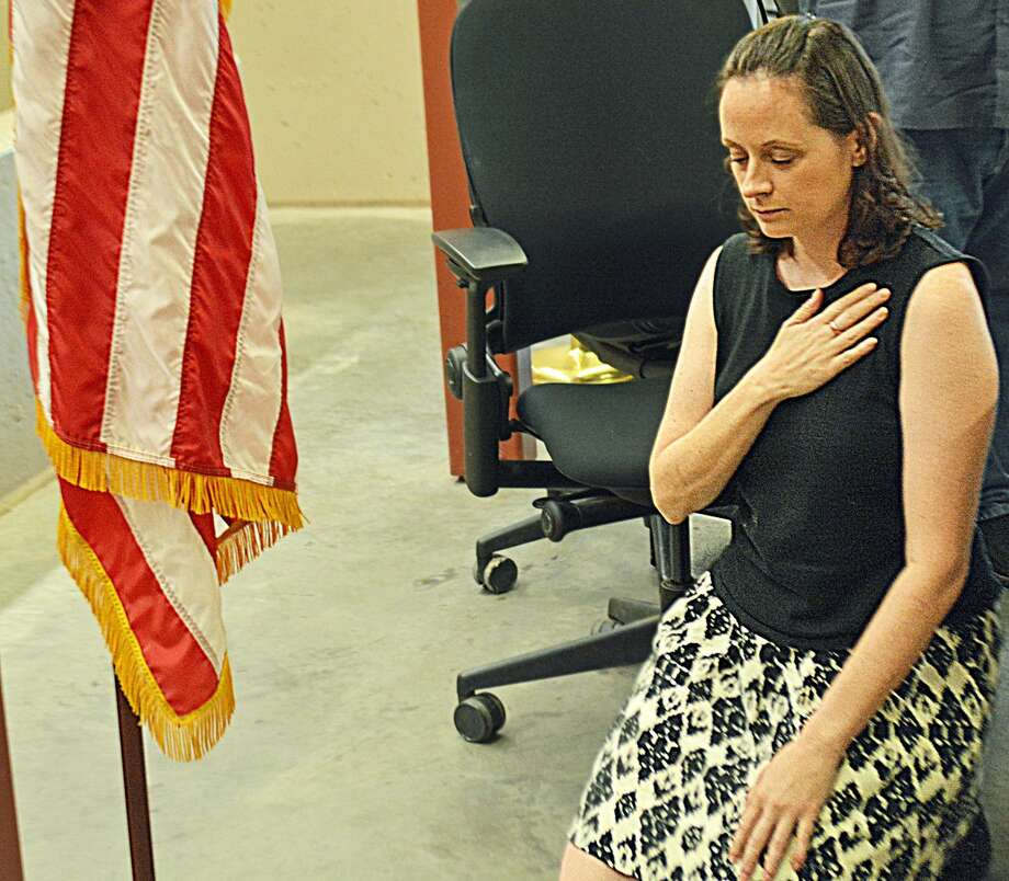 Haddam Selectwoman Melissa Schlag was condemned during the Board of Selectmen's meeting Monday night, as person after person spoke against her taking a knee two weeks ago at the town meeting when the Pledge of Allegiance was recited. Her supporters formed a long line along the driveway leading to the Haddam firehouse, where the meeting was held.