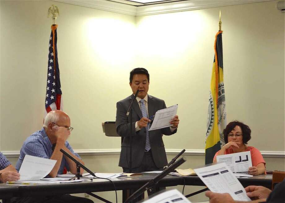 David Lee, president of Dahab Associates, Inc., the investment company that oversees Hamden's retirement portfolio, addresses the Hamden Employees Retirement Board at its monthly meeting.
