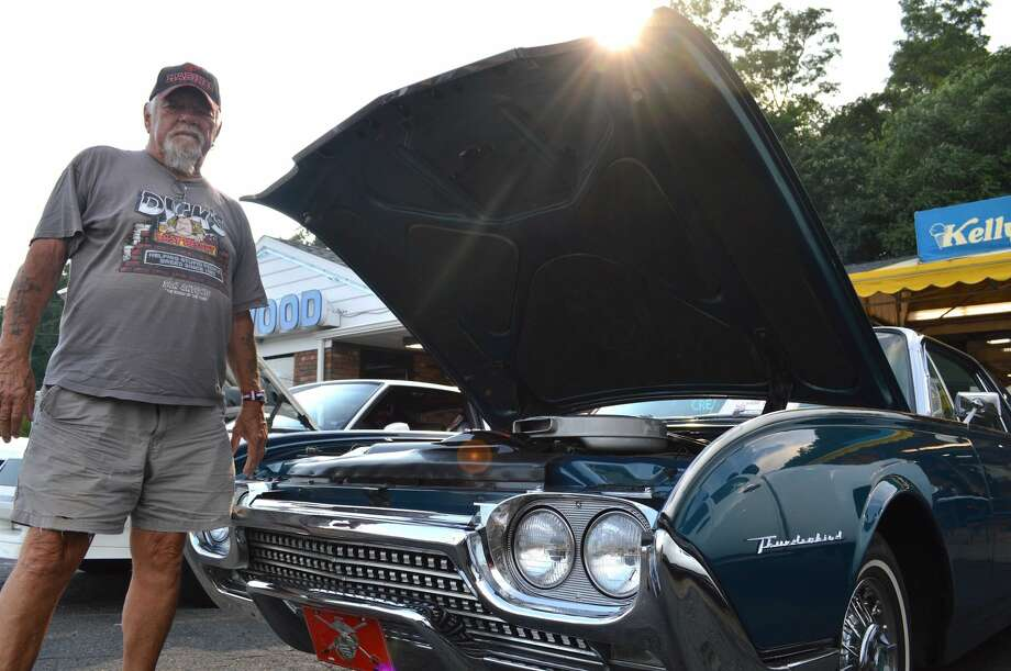 John Nerkowski of Wallingford stands with his '62 T-Bird at the rally.