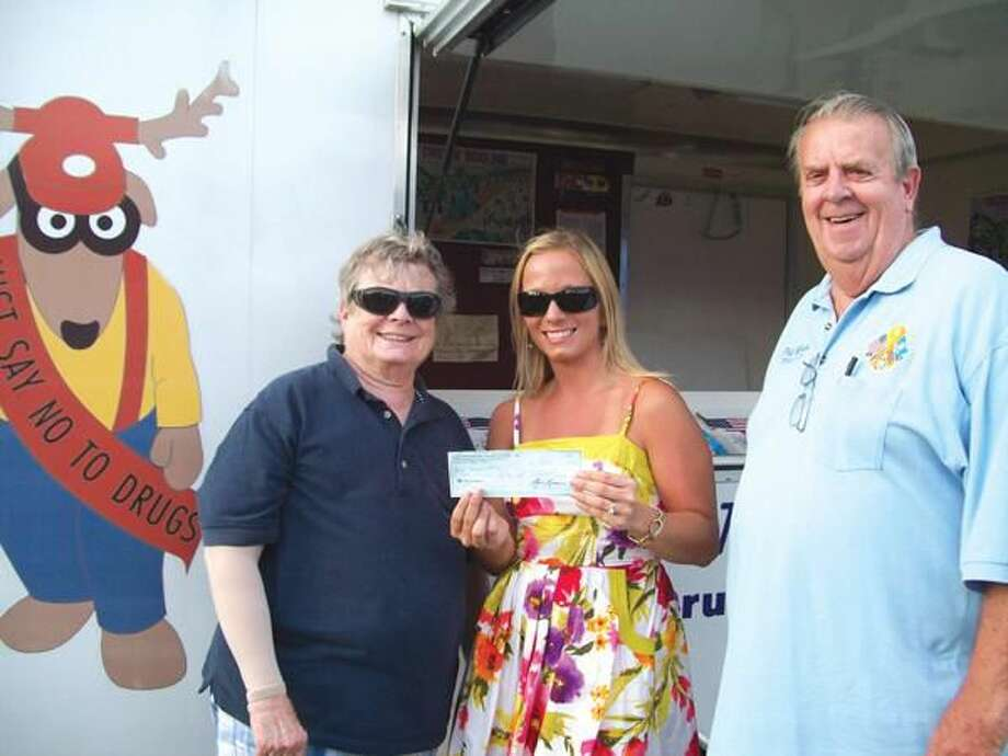 Submitted Photo Shown at the event submitting a $150 donation are, left to right, Brenda Davis, Drug Awareness Chair; Beth Studniarski, Hamden Youth Services Outreach Counselor; and Phil Wilson, Lodge member and Past President of the Connecticut Elks Association. Behind them