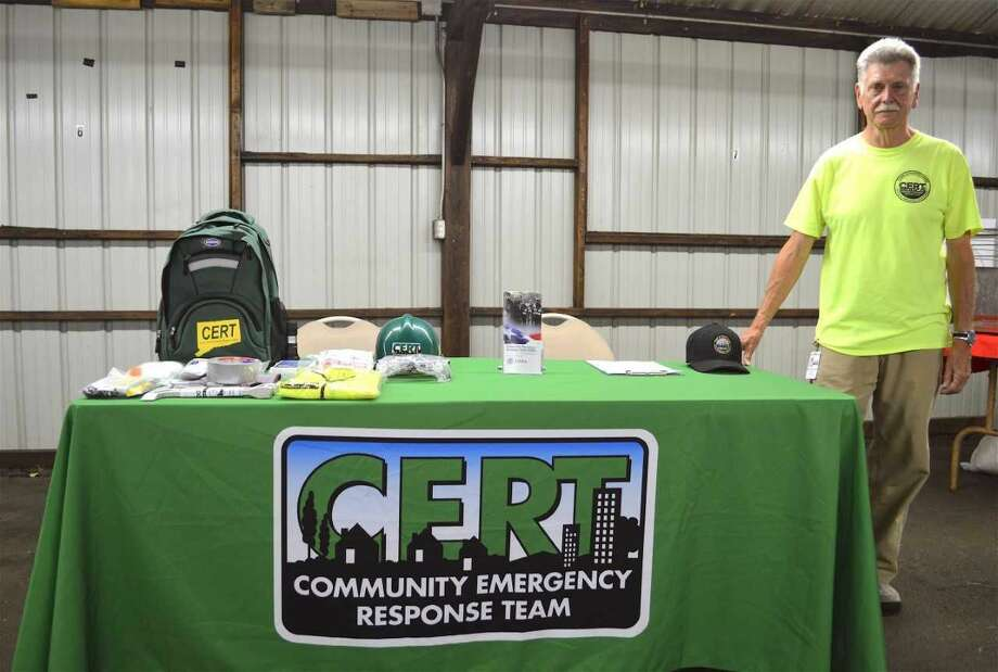 Barry Simmons of North Haven, trying to encourage new recruits recently at the North Haven Fair.