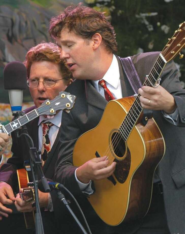Submitted Photo Acclaimed bluegrass singer, songwriter and instrumentalistTim O'Brien, left, and guitarist Bryan Sutton, right, will perform in Hamden Oct. 2.