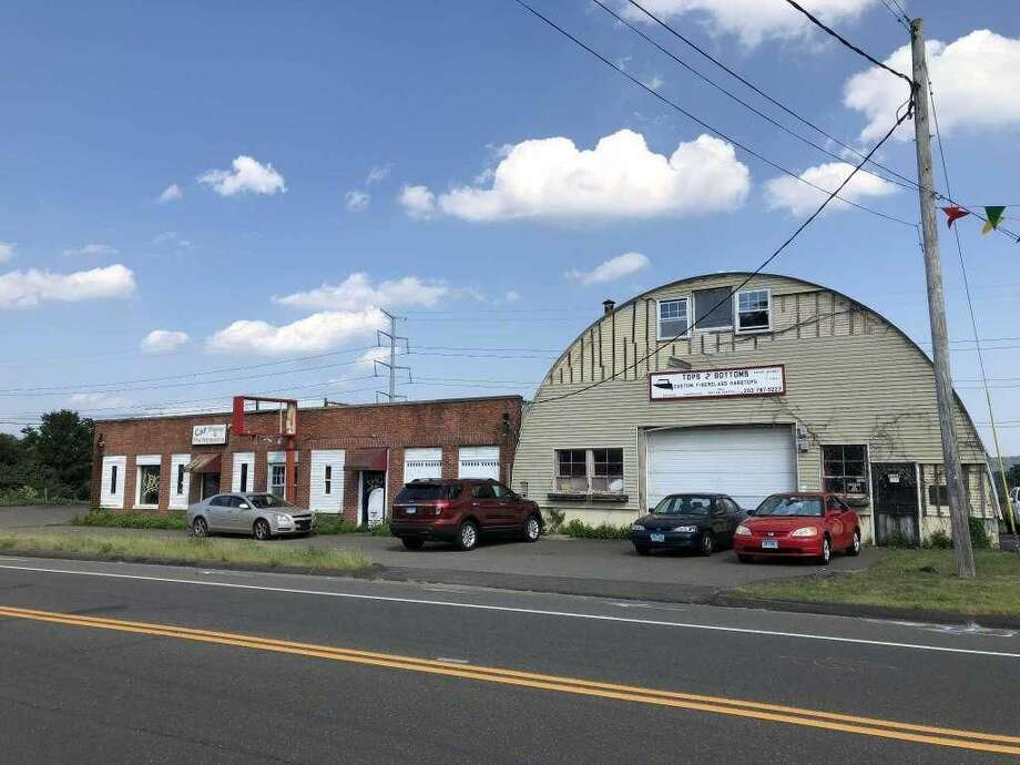 The former Stereo Station property at 2259 State St. in Hamden is set to be rehabilitated and turned into a used car dealership.