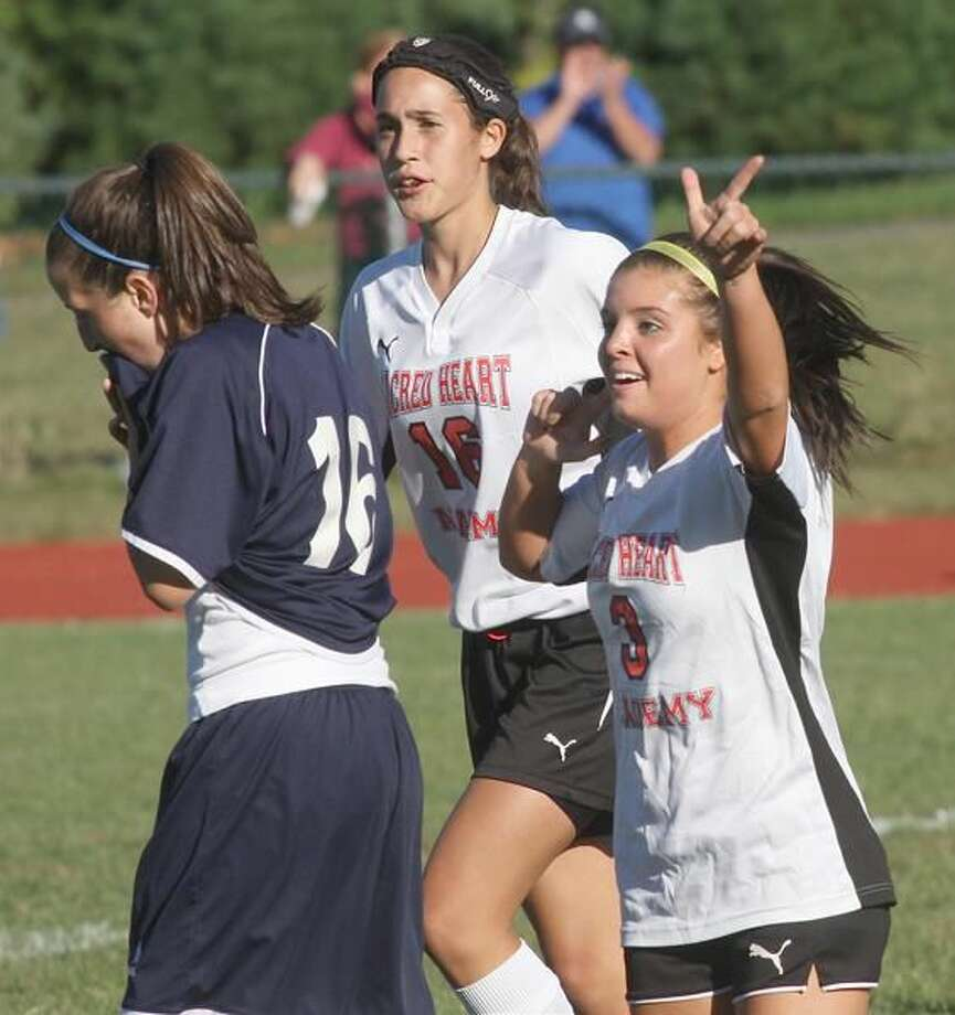 Photo by Russ McCreven Sacred Heart co-captain Cassie Slowik (3) celebrates a goal in the Pacers' 4-2 victory over Foran.
