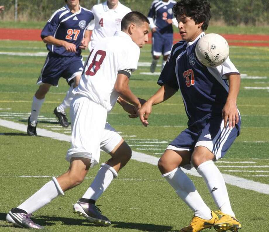 Photo by Russ McCreven Sheehan's Mario Yepez makes his move past a Lyman Hall player and looks to gain control of the ball in a recent game. Yepez has helped lead the Titans to two wins and a tie in their last four games.