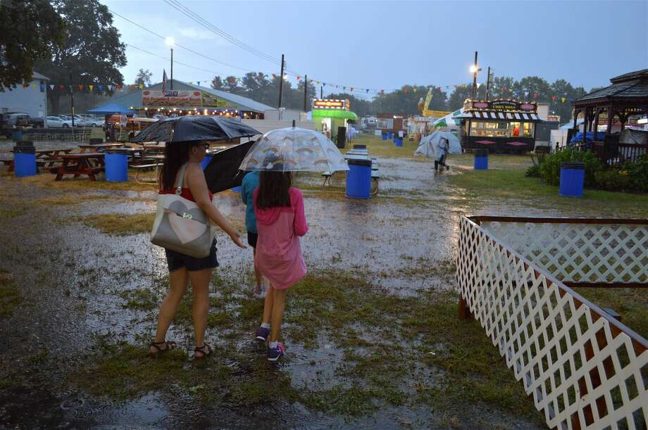Fair patrons get a little wet on the event's first evening.