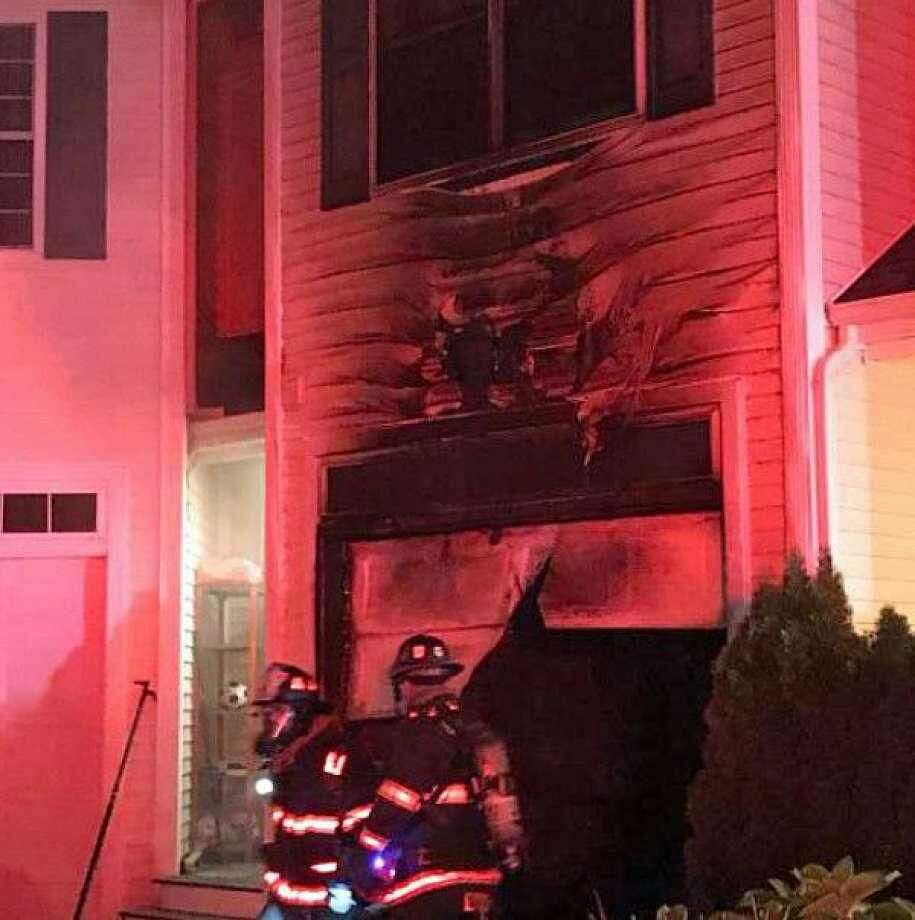Firefighters knocked down a garage fire on Sanford Street on Wednesday, Sept. 27, on Sanford Street. A family of three was displaced because of smoke damage in their condo that is above the garage.