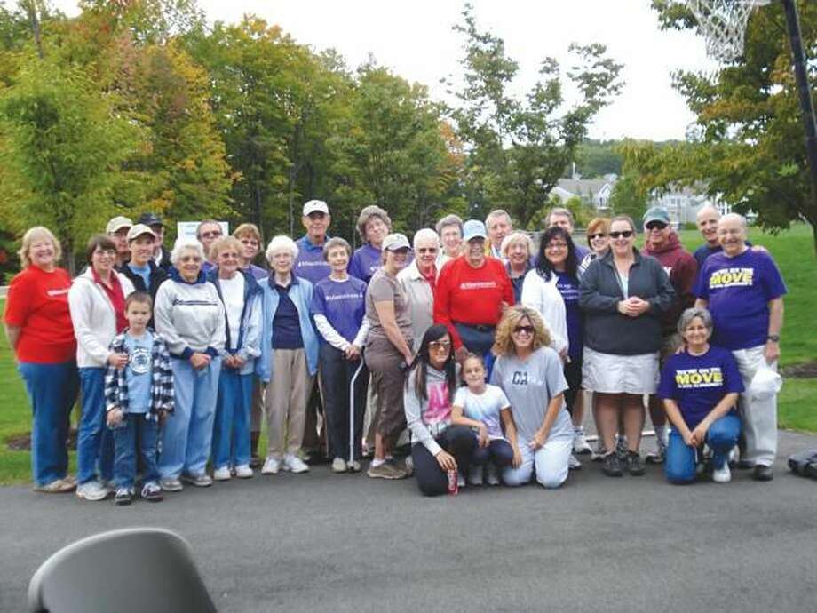 Submitted Photo Masonicare employees, residents and family members joined together to participate in an event to raise funds for the Alzheimer's Association, Connecticut Chapter, Sept. 26.