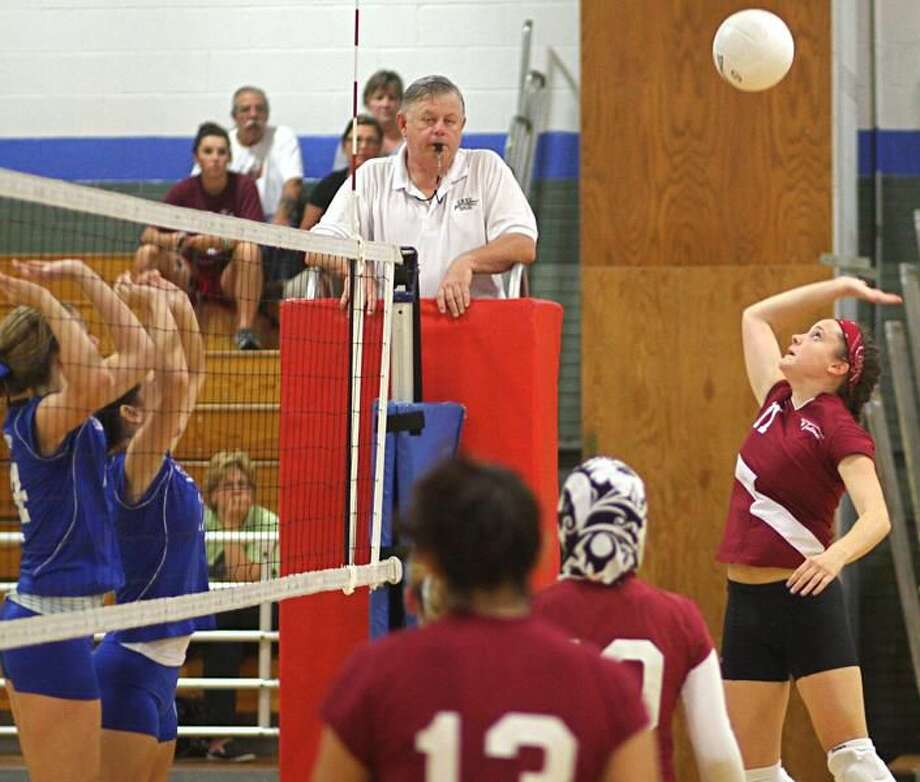 Photo by Russ McCreven North Haven tri-captain Kayla Brown gets set to hit the ball over the net against West Haven.