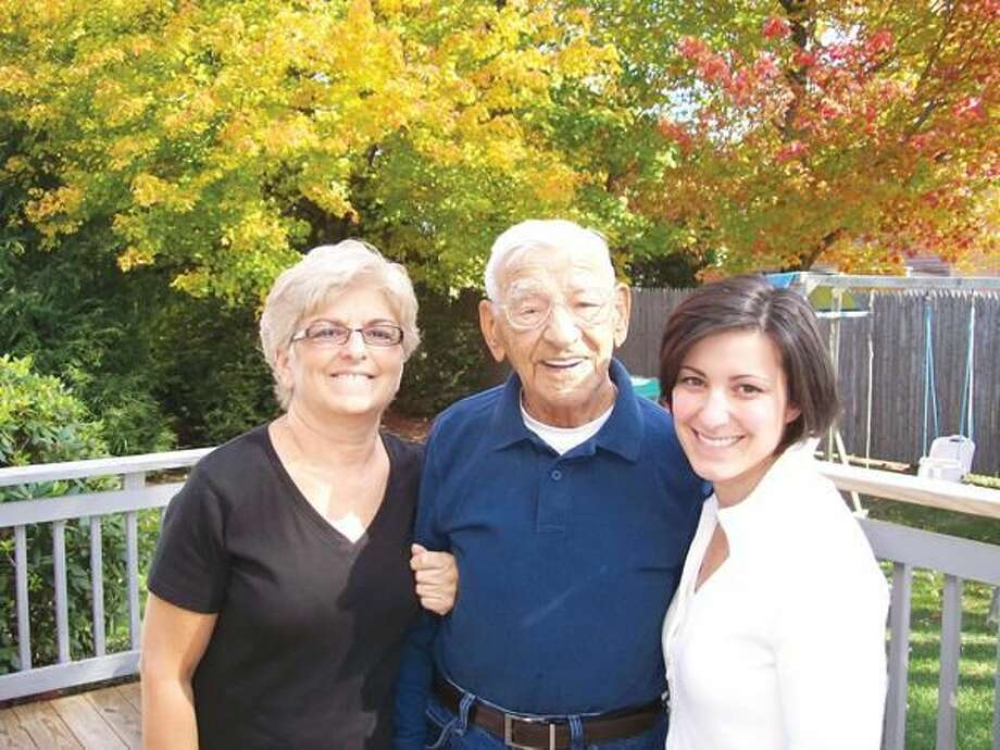 "Photo by Lynn Fredricksen Pictured left to right: Frank ""Nukie"" Nuclo, center, enjoys a beautiful autumn day at home with his daughter, Esther DeAnglis, left, and granddaughter Debbie Flonc, right."