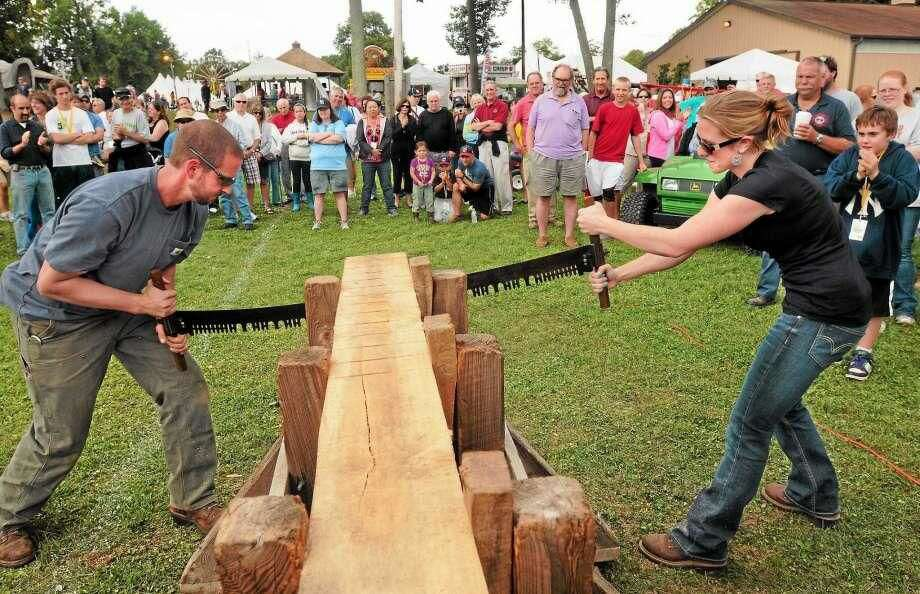 File photo from 2018 Orange Country Fair: Ben Watts and his girlfriend Cara Shamansky, both of Bethany, compete to have the fastest time in the Jack-and-Jill, two-person hand-saw contest.