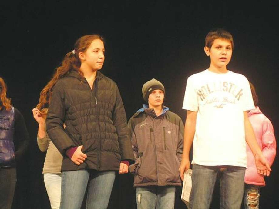 """Submitted Photo Hamden Middle School students Maisie Albis, Josh Goldberg, and Raymond Looney rehearse for the school's presentation of """"Snow Angel."""""""