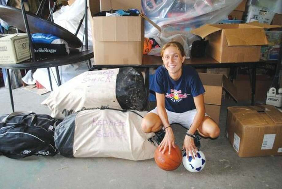 Submitted Photo Ahna Johnson with the used baseball equipment donated by residents for the Enrique de Ossó Central School in Managua, Nicaragua.