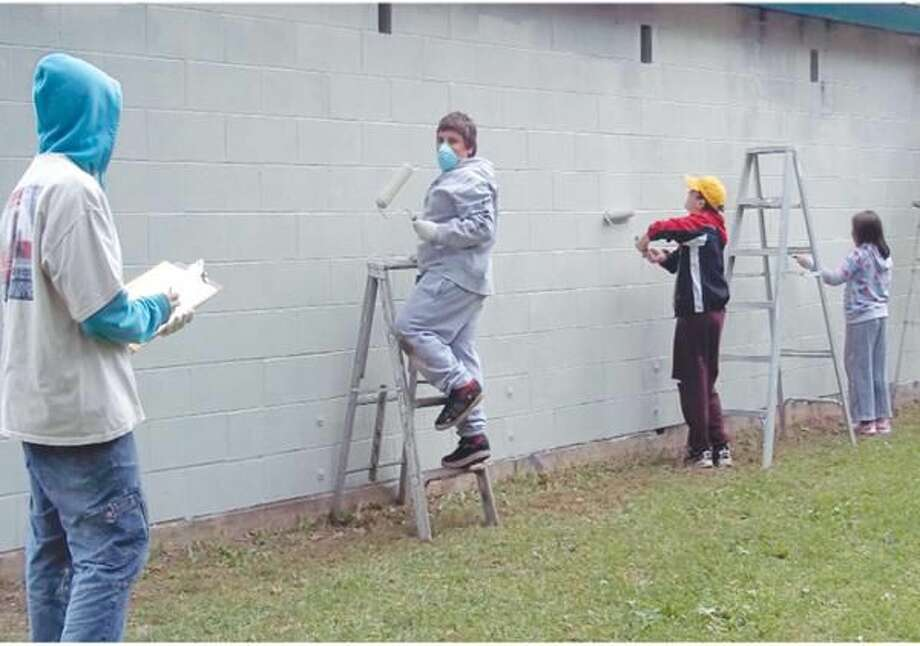 Submitted Photo Scout Julian Davie, far left, recently led efforts to renovate and repaint the dugouts at Legion Field in Hamden as part of his Eagle Scout Project.