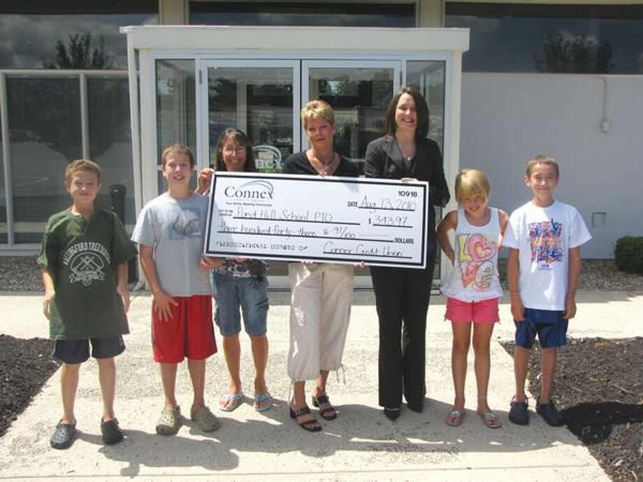 Submitted Photo Pictured, left to right, are: Austyn Heidgerd and Aeron Heidgerd, Pond Hill School students; Linda Heidgerd and Sarah Vining, Pond Hill School PTO co-presidents; Tansley Stearns, vice president of sales and service at Connex Credit Union; and Lily Vining and Ethan Heidgerd, Pond Hill School students.