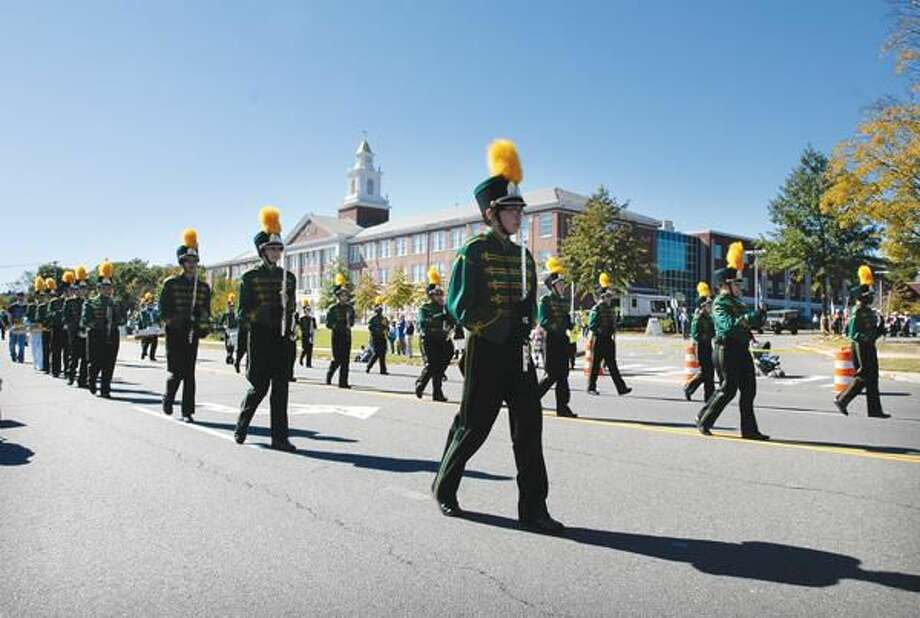 Photo by Peter Casolino The Hamden High School Marching band marches during the Greater New Haven Columbus Day Parade on Dixwell Avenue in Hamden Sunday.