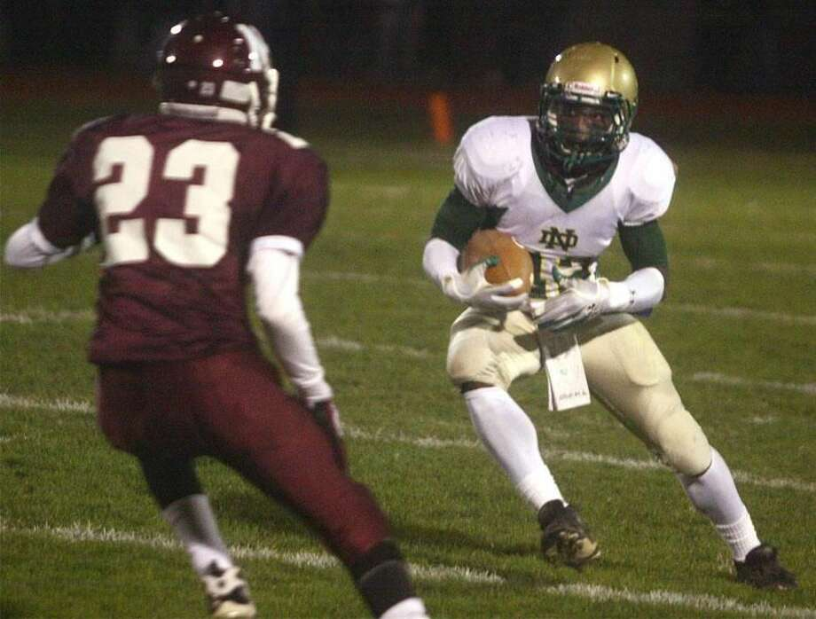 Photo by Russ McCreven Notre Dame's Tirell Young-Williams looks to make his move past North Haven's Matt Manemeit.