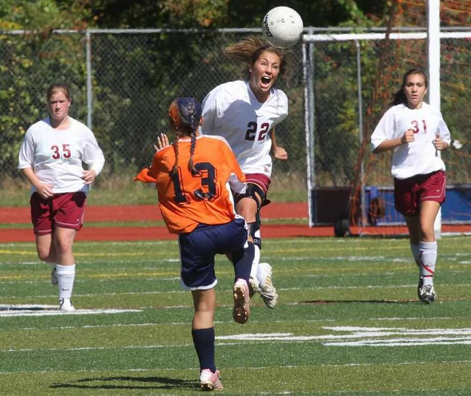 Photo by Russ McCreven Sheehan's Stephany Cunha heads the ball against cross-town rival Lyman Hall earlier this season. The Titans swept the season series with a 4-2 victory last Saturday night at Fitzgerald Field.