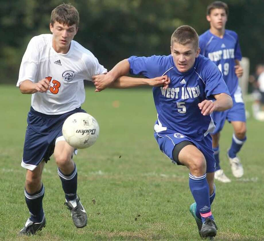 Photo by Russ McCreven West Haven's Dillon Long battles Lyman Hall's Brent Cornwell for the ball in the Westies' 3-1 victory last week.