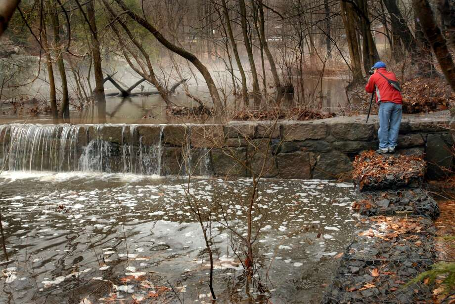 Charles Lee, of Shelton, photographs the mist on the Mill River as he visits Sleeping Giant State Park in Hamden.