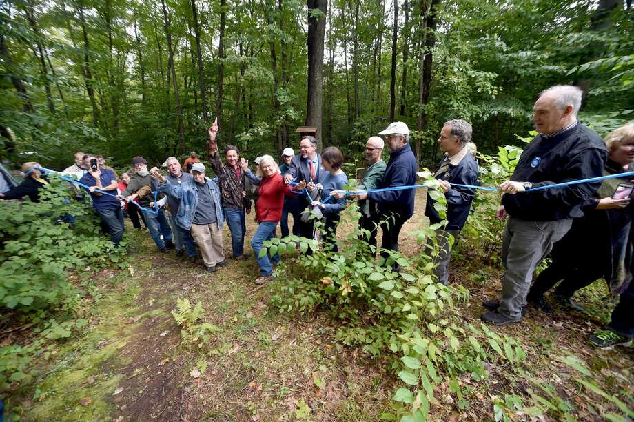 A ribbon is cut during the dedication of the Edgar L. Heermance Section of the Quinnipiac Trail off of Rocky Top Road in Hamden on Sept. 28.