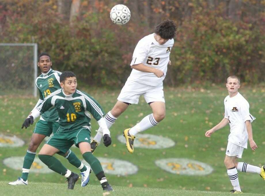 Photo by Russ McCreven Amity's Niko Coutromanis heads the ball last week against Hamden.