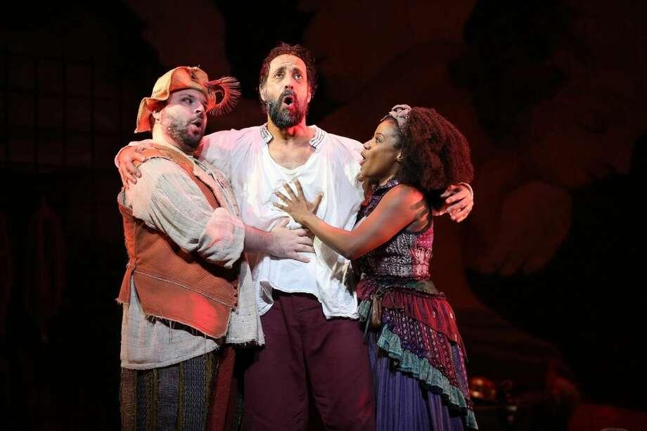 "From left, Tony Manna as Sancho Panza, Philip Hernandez as Don Quixote, and Gisela Adisa as Aldonza in ""Man of La Mancha."""