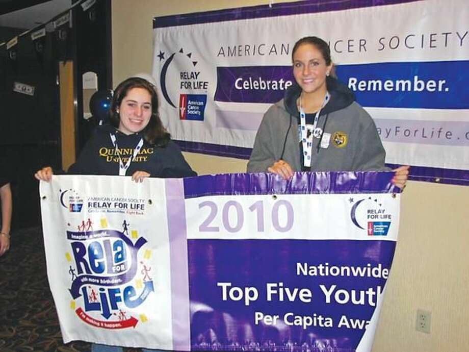 Submitted Photo Quinnipiac University students Megan Caminsky, left, and Ashley Chacon-Baker accept The Top 5 Youth Per Capita Award at the American Cancer Society's New England Relay for Life College Summit.