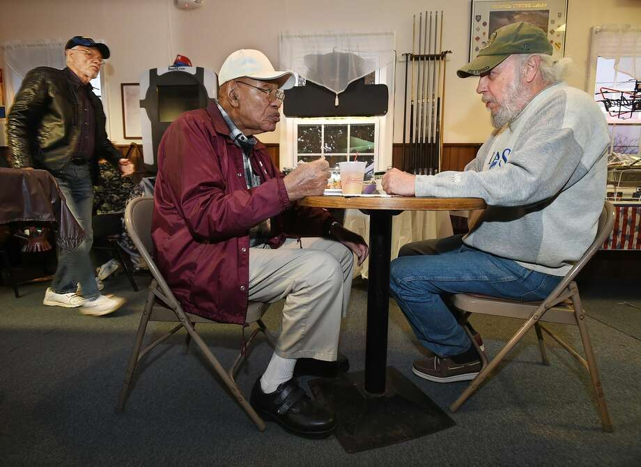 Hamden veterans Charles Patterson, 86, at left and Hamden native Steve Fletcher, 67, enjoy a free dinner at American Legion Post 88 at Dixwell Avenue in Hamden on Veterans Day, Friday, November 11, 2016, prepared by Zafar Farooqui and JoAnn Corder. Patterson served in the U.S. Army in Austria, Germany and Italy during the Korean Conflict and Fletcher served in the U.S. Army Reserves in Desert Storm. In the background is Hamden veteran Bob Schwarz, 74, who served in the U.S. Army from 1960-64, who was flying into Guantanamo Bay as the Vietnam War began. (Catherine Avalone/New Haven Register)